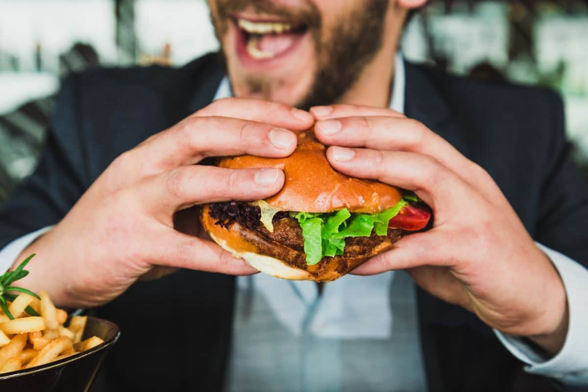 Man Eating a Hamburger: The Food Looks Good 'AF'