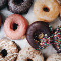 Box of Donuts With Different Varieties. Sprinkles and Glazed