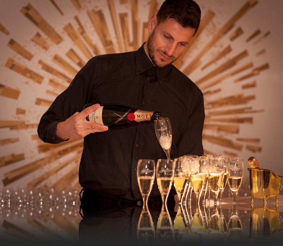 Man Pouring Champagne into Glasses