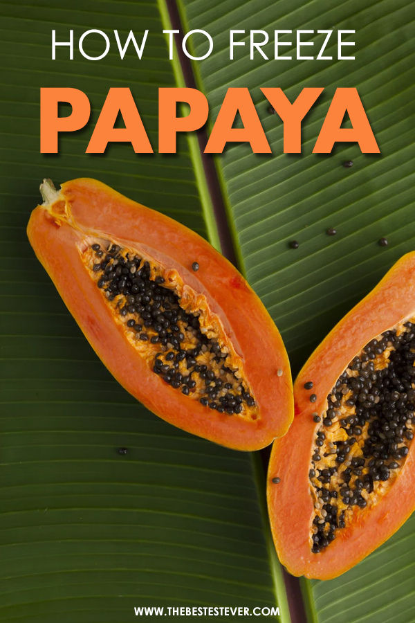 Papaya cut in two, sitting on a leaf