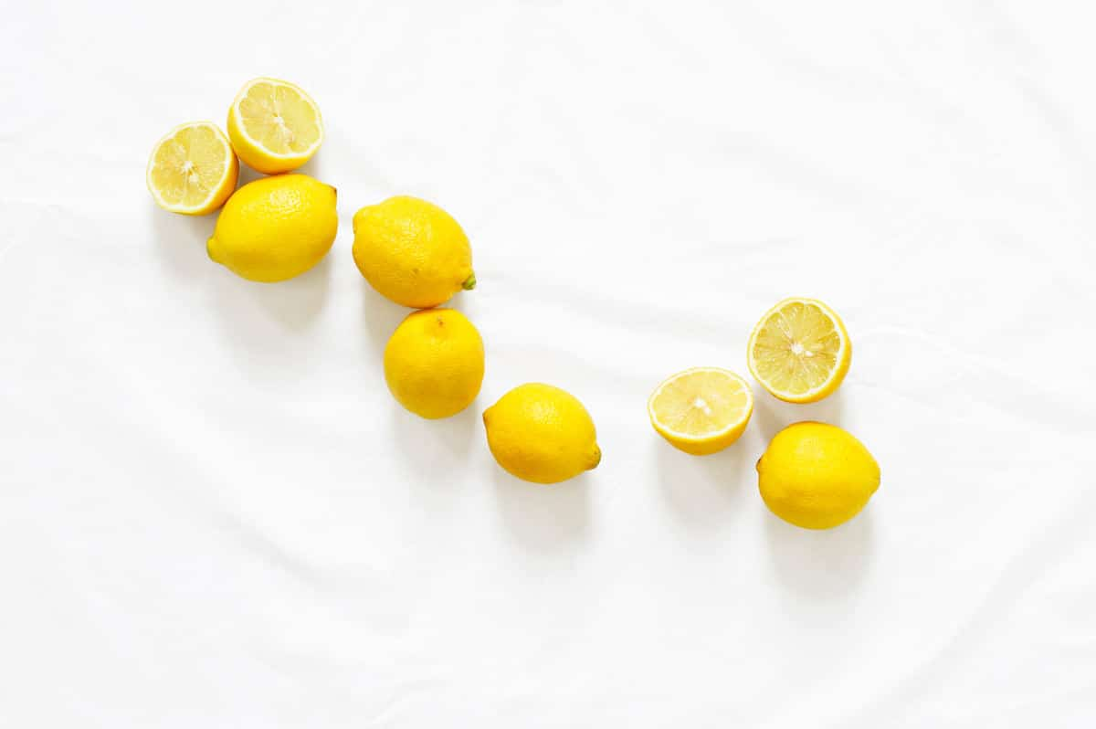Cut Lemons on a White Tablecloth