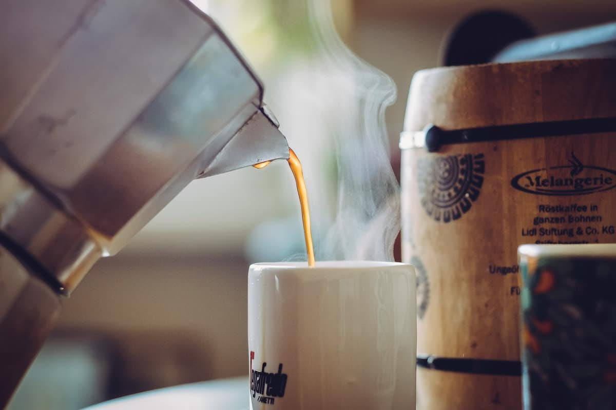 Cup of Coffee Being Poured: (Why You Should Never Reheat This Beverage)
