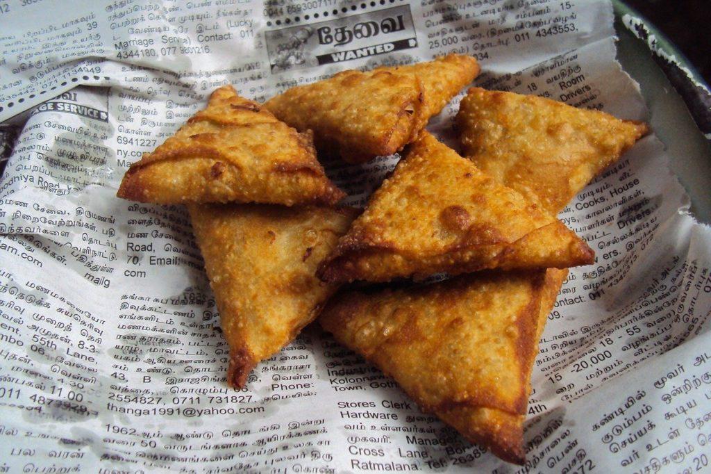 Fried Samosas Drying on Newspaper