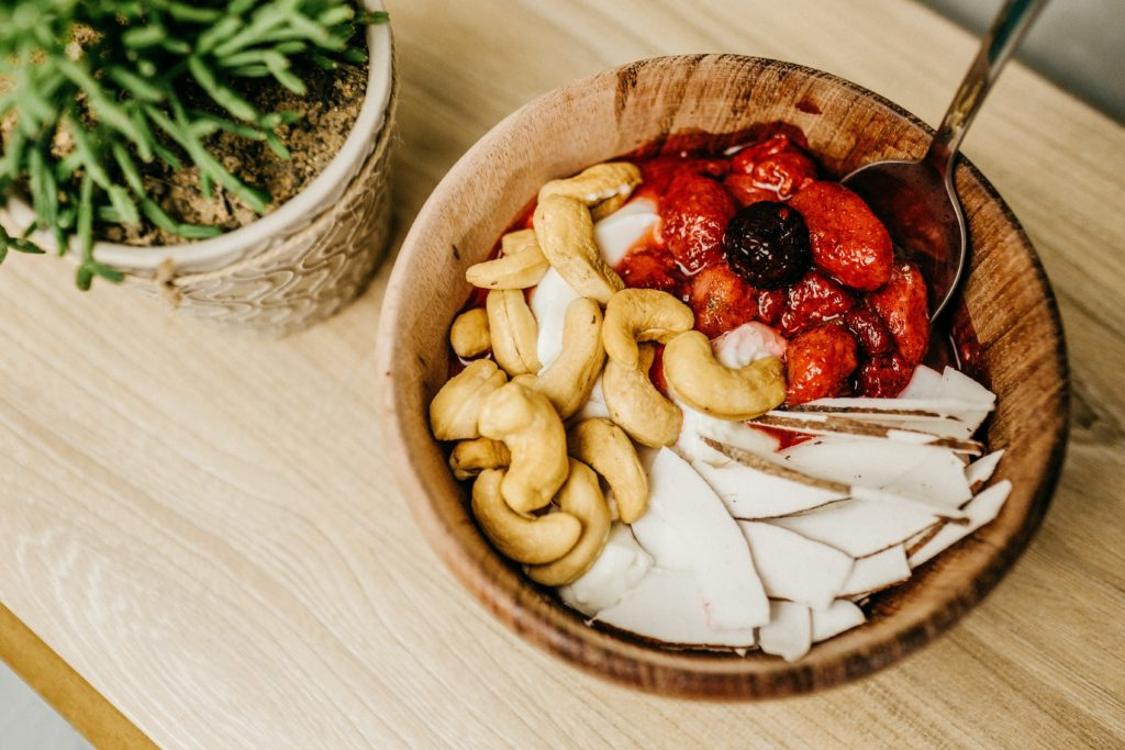 Wooden Bowl with fruit and nuts