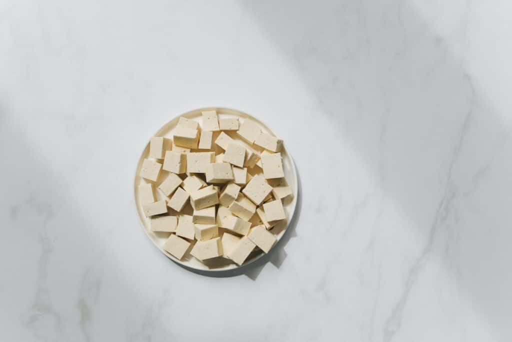 tofu in a bowl, sitting on a marble countertop