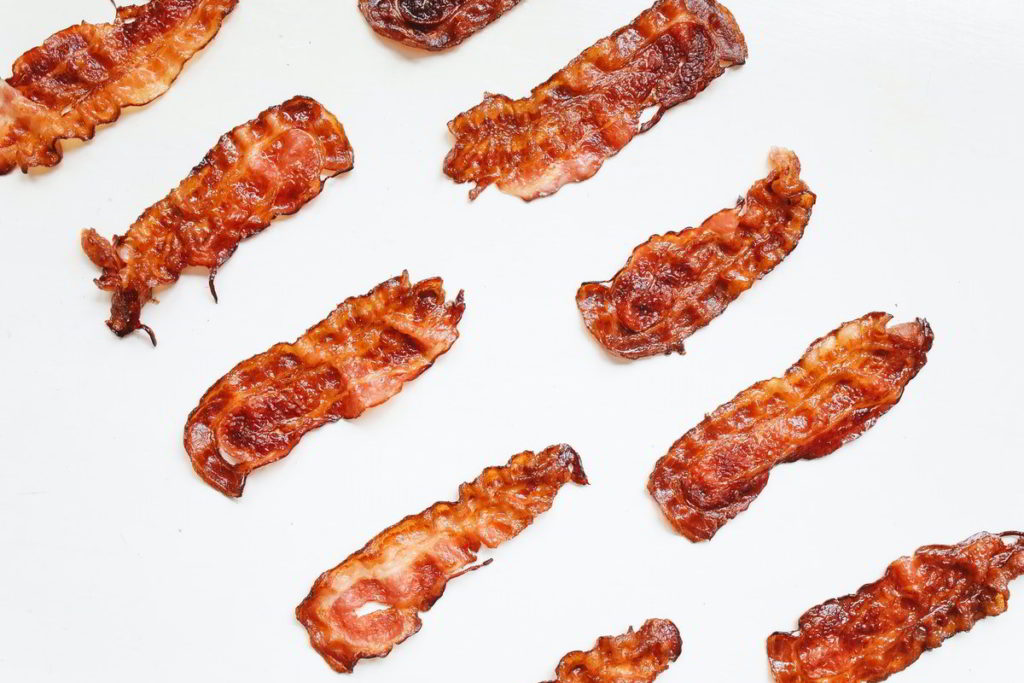 Strips of Bacon on a White Background