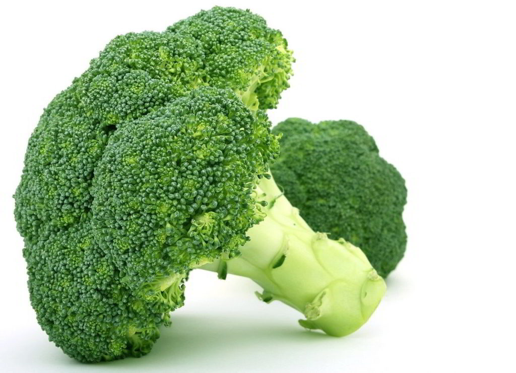 Head of Broccoli on a white table