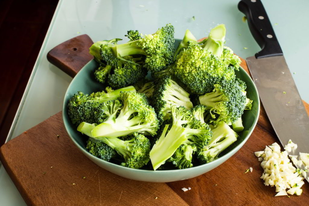 Broccoli florets sliced and in a bowl